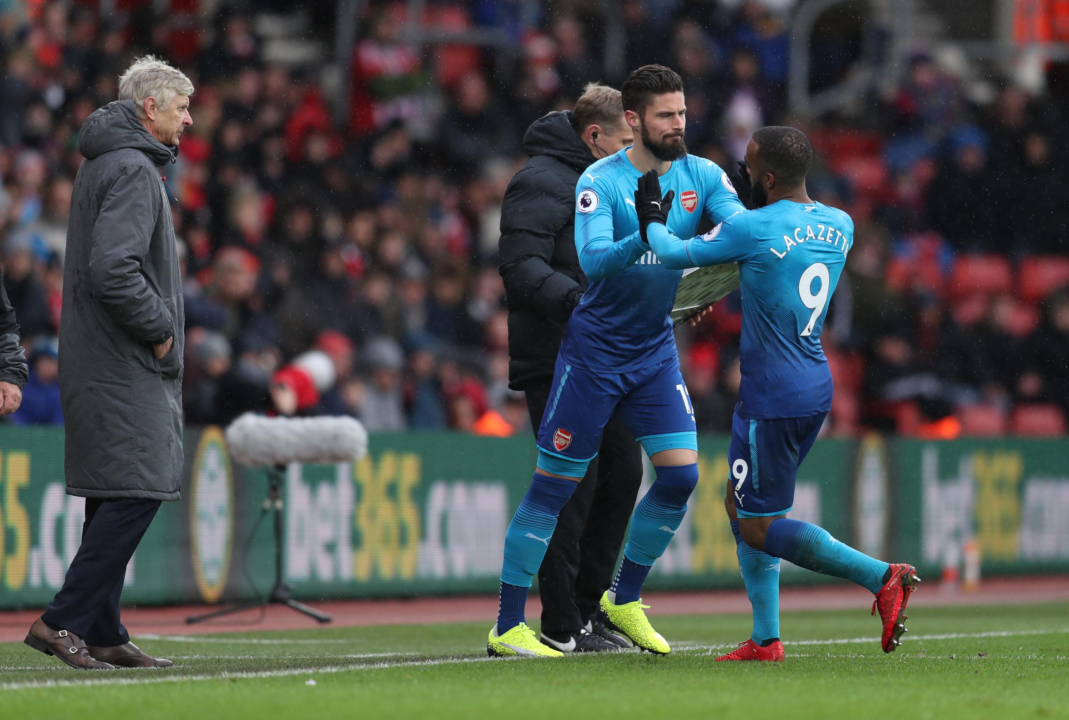 Wenger sidesteps title talk but 'won't give up'